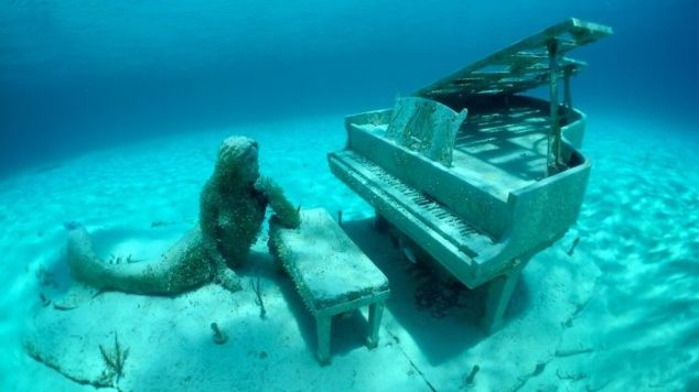 mermaid underwater piano